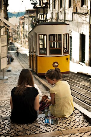 painter - Portugal, Distrito de Lisboa, Lisbon, Bairro Alto, two young girl painting the tram of elevador da Bica, Stock Photo - Rights-Managed, Code: 862-05998862