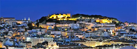 The historical centre and the Sao Jorge castle at dusk. Lisbon, Portugal Stock Photo - Rights-Managed, Code: 862-05998970