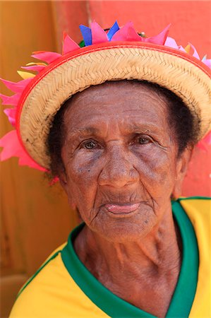 south american woman - South America, Brazil, Maranhao, Sao Luis, Sao Jose de Ribamar, old lady reveller in a Brazilian football shirt at the Bumba Meu Boi celebrations in the streets of the town Stock Photo - Rights-Managed, Code: 862-06540909