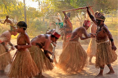 South America, Brazil, Miranda, Terena indigenous people from the Brazilian Pantanal performing a ritual stick dance in grass skirts Stock Photo - Rights-Managed, Code: 862-06540981
