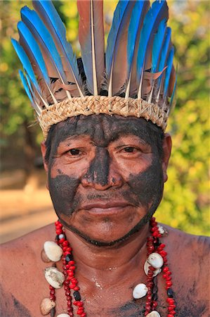 South America, Brazil, Miranda, Terena indigenous man from the Pantanal in a Macaw feather headdress Stock Photo - Rights-Managed, Code: 862-06540982
