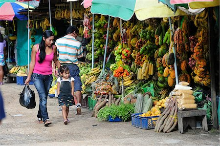 south american woman - South America, Colombia, Leticia, Amazon region, Woman walking in a market with her daughter Stock Photo - Rights-Managed, Code: 862-06541021