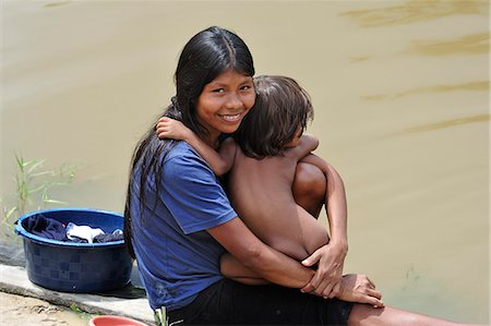 Mother and child at the Amacayon Indian Village, Amazon river, Puerto Narino, Colombia Stock Photo - Rights-Managed, Code: 862-06541033