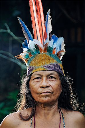 Indian woman with head dress, Ticuna Indian Village of Macedonia, Amazon River, near Puerto Narino, Colombia Stock Photo - Rights-Managed, Code: 862-06541044