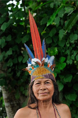 Indian woman with head dress, Ticuna Indian Village of Macedonia, Amazon River, near Puerto Narino, Colombia Stock Photo - Rights-Managed, Code: 862-06541041