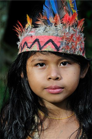 Ticuna girl with head dress, Ticuna Indian Village of Macedonia, Amazon River,near Puerto Narino, Colombia Stock Photo - Rights-Managed, Code: 862-06541043