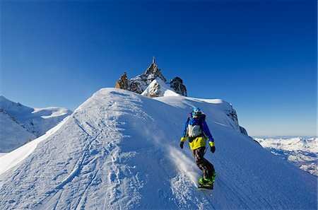sports and snowboarding - Europe, France, French Alps, Haute Savoie, Chamonix, Aiguille du Midi, snowboarder starting the Vallee Blanche off piste Stock Photo - Rights-Managed, Code: 862-06541653