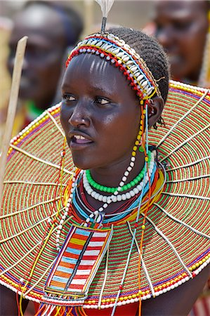 A young Pokot woman sings to celebrate the opening of a new pre primary school at Ngaini, a remote area of the Kerio Valley. Despite her youth, her jewellery denotes she is already married. Stock Photo - Rights-Managed, Code: 862-06542264