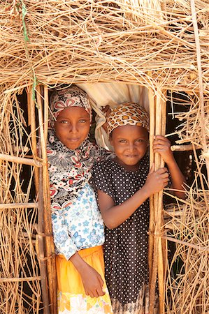 Merti, Northern Kenya. Two children peer from the door of their home. Stock Photo - Rights-Managed, Code: 862-06542285