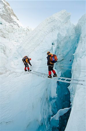 Asia, Nepal, Himalayas, Sagarmatha National Park, Solu Khumbu Everest Region, the Khumbu icefall on Mt Everest, climbers crossing ladders over a crevasse Stock Photo - Rights-Managed, Code: 862-06542438