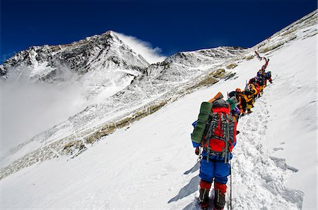 Asia, Nepal, Himalayas, Sagarmatha National Park, Solu Khumbu Everest Region, a line of climbers on the Lhotse Face approaching the Yellow Band with Everest, 8850m, above Stock Photo - Rights-Managed, Code: 862-06542487