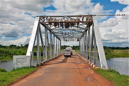 This bridge over a fast flowing river in Central Uganda once formed part of an emergency wartime bridge over the River Thames, Uganda, Africa Stock Photo - Rights-Managed, Code: 862-06543303
