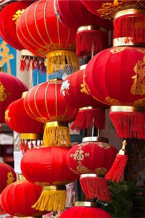 China, Yunnan, Jianshui. Lanterns hanging up outside a shop in Jianshui. Stock Photo - Rights-Managed, Code: 862-06676269