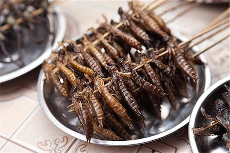 China, Yunnan, Jianshui. Fried earwigs for sale in Jianshui. Stock Photo - Rights-Managed, Code: 862-06676281