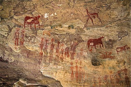 drawing (artwork) - Chad, Terkei West, Ennedi, Sahara.  An ancient rock art panel of human figures with large decorated hairstyles and domesticated animals. Stock Photo - Rights-Managed, Code: 862-06676529