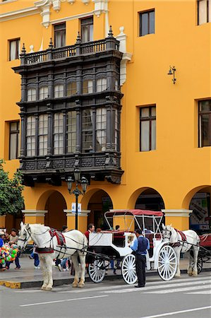 South America, Peru, Lima, a horse and carriage stand in front of a wooden balcony window on the Union Club situated on the main square in the colonial city centre Stock Photo - Rights-Managed, Code: 862-06677273