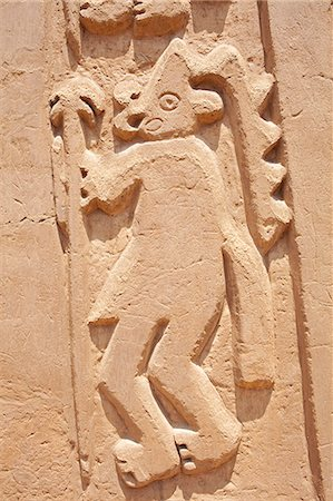 South America, Peru, La Libertad, Trujillo, an adobe bas relief from a mural on the Chimu House of the Dragon showing a figure in a headdress, part of the UNESCO World Heritage Listed Chan Chan archeological complex Stock Photo - Rights-Managed, Code: 862-06677311