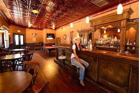 saloon - Cowgirl sitting at bar in Old Saloon at Apache Spirit Ranch, Tombstone, Arizona, USA Stock Photo - Rights-Managed, Code: 862-06677533