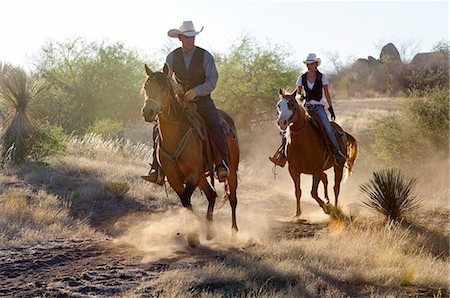 Cowboy and Cowgirl, Apache Spirit Ranch, Tombstone, Arizona, USA Stock Photo - Rights-Managed, Code: 862-06677548