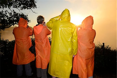 People with colorful rain coats at Victoria Falls, sunrise, Zambezi River, near Victoria Falls, Zimbabwe, Africa Stock Photo - Rights-Managed, Code: 862-06677644