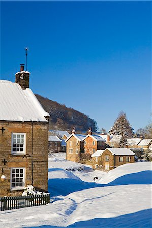 small town snow - United Kingdom, England, North Yorkshire, Hutton-Le-Hole. A picturesque and much visited village in the North York Moors National Park. Stock Photo - Rights-Managed, Code: 862-06825416