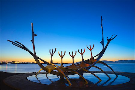 Iceland, Reykjavik, Solfar (Sun Voyager), iconic stainless-steel modern sculpture representing a Viking longboat by Jon Gunnar Arnason Stock Photo - Rights-Managed, Code: 862-06825655
