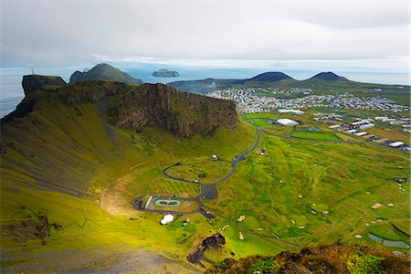 Iceland, Vestmannaeyjar, volcanic Westman Islands, Heimaey Island, golf course in volcanic crater Stock Photo - Rights-Managed, Code: 862-06825697