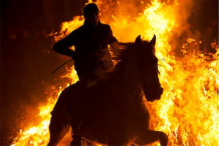 fire - Spain, Castille & Leon, Avila, San Bartolome de Pinares, Men and horses jumping through fire on the eve of the feast of San Antonio, as a tradition to purify the animals. Stock Photo - Rights-Managed, Code: 862-06826217