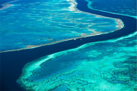 queensland - Australia, Queensland, Whitsundays, Great Barrier Reef Marine Park.  Aerial view of The River, a 200 ft deep channel running between Hardys Reef and Hook Reef. Stock Photo - Rights-Managed, Code: 862-07495757