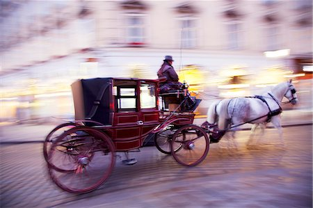 Austria, Vienna. Horse carriage passing through streets in the historical centre Stock Photo - Rights-Managed, Code: 862-07495775