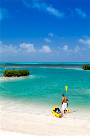 sandi model - Central America, Belize, Belize district, Little Frenchman Caye, Royal Palm Island, a young man with a kayak looks out to the Caribbean Sea Stock Photo - Rights-Managed, Code: 862-07495806