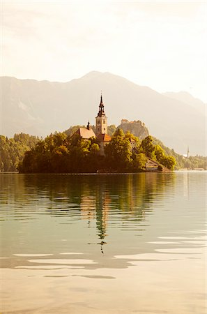 Slovenia, Julian Alps, Upper Carniola, Lake Bled. Morning mist on Lake Bled island and surroundings. Stock Photo - Rights-Managed, Code: 862-07690773