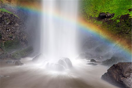 rainbow - Uganda, Sipi. A rainbow arches over the final 99 metres drop of Sipi Falls. The Sipi River rises on Mount Elgon, a massive extinct volcano, before cascading down the mountainside over four attractive waterfalls. Stock Photo - Rights-Managed, Code: 862-07690949