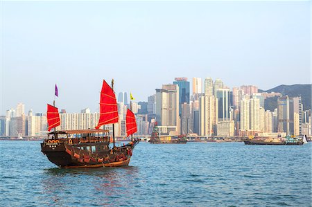 Hong Kong, China. Traditional chinese junk sail in Victoria harbour Stock Photo - Rights-Managed, Code: 862-07909484