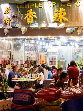 Hong Kong, China. Night view of street with restaurants Stock Photo - Rights-Managed, Code: 862-07909483
