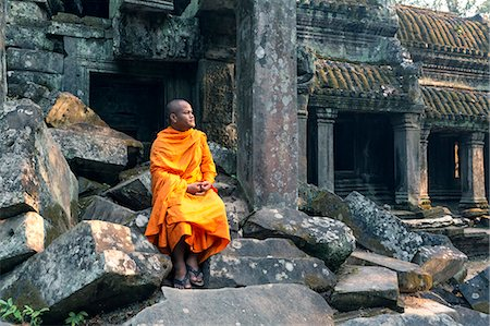 Cambodia, Siem Reap, Angkor Wat complex. Buddhist monk inside Ta Prohm temple (MR) Stock Photo - Rights-Managed, Code: 862-07909509