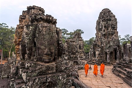 Cambodia, Siem Reap, Angkor Wat complex. Monks inside Bayon temple, at sunrise (MR) Stock Photo - Rights-Managed, Code: 862-07909524