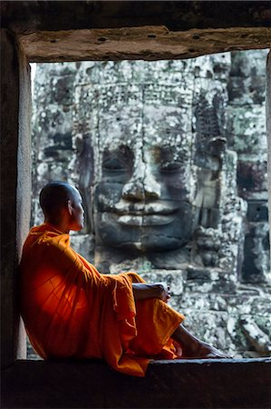 Cambodia, Siem Reap, Angkor Wat complex. Monks inside Bayon temple (MR) Stock Photo - Rights-Managed, Code: 862-07909523