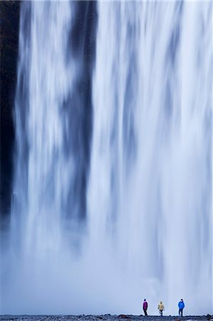 people falling - Iceland, Skogafoss. The 62m high waterfall of Skogafoss topples over a rocky cliff at the western edge of Skogar. Stock Photo - Rights-Managed, Code: 862-07909912