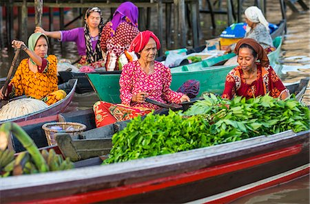Indonesia, South Kalimatan, Lok Baintan. A picturesque scene at a floating market on the Barito River. Stock Photo - Rights-Managed, Code: 862-07909921