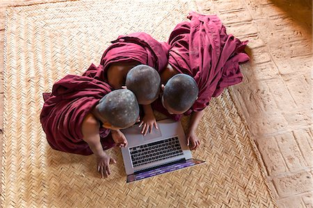 Myanmar, Mandalay division, Bagan. Three novice monks using a laptop in a pagoda, shot from above (MR) Stock Photo - Rights-Managed, Code: 862-07910320