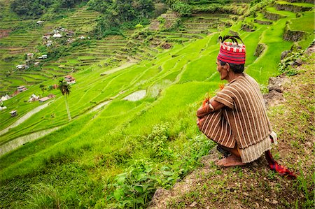 philippine terrace farming - Asia, South East Asia, Philippines, Cordilleras, Banaue; an Ifugao man in traditional clothing looks out over the UNESCO World heritage listed Ifugao rice terraces between in Batad Stock Photo - Rights-Managed, Code: 862-07910422