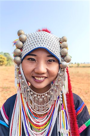 Thailand, Chiang Rai. Portrait of woman of Ahka tribe wearing traditional dress and headgear with silver coins (MR) Stock Photo - Rights-Managed, Code: 862-07910817