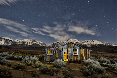 Abandoned cabin at night with Sierra Nevada mountains in back, Mono Lake, Eastern Sierra, California, USA Stock Photo - Rights-Managed, Code: 862-07911007