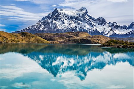 Chile, Torres del Paine, Magallanes Province. Cerro Paine Grande reflected in Lake Pehoe.  One of the principal attractions of Torres del Paine National Park is the magnificent Paine massif. Stock Photo - Rights-Managed, Code: 862-08090055