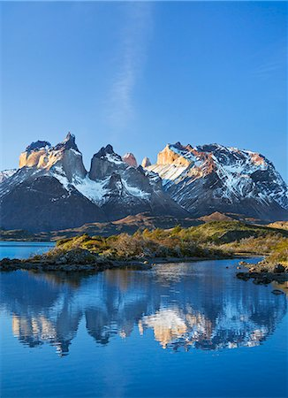 Chile, Torres del Paine, Magallanes Province. The principal attraction of the Torres del Paine National Park is the Paine massif with its granite spires and the contrasting igneous, sedimentary and metamorphic rocks of Ceurnos de Paine. Stock Photo - Rights-Managed, Code: 862-08090050