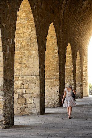 release - Woman walking along the Venetian shipyard, Heraklion, Crete, Greece, Europe  MR 0009 Stock Photo - Rights-Managed, Code: 862-08090275