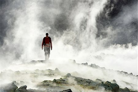 Hiker on the Gran craters walks through Steam, Vulcano Island, Aeolian, or Aeolian Islands, Sicily, Italy, Europe, MR Stock Photo - Rights-Managed, Code: 862-08090535