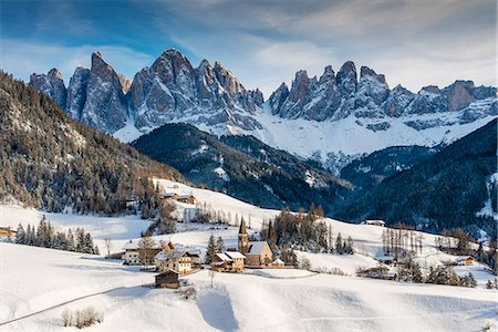 Scenic winter view of Santa Maddalena or St Magdalena mountain village with the Puez-Geisler Dolomites in the background, Villnoss or Val di Funes, Alto Adige - South Tyrol, Italy Stock Photo - Rights-Managed, Code: 862-08090627