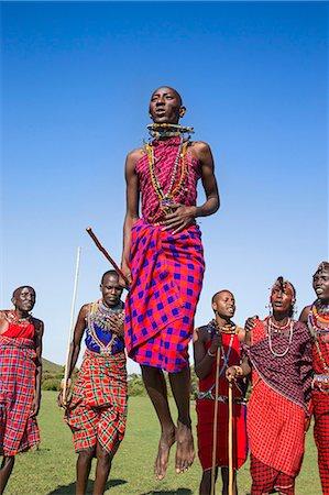 Africa, Kenya, Narok County, Masai Mara. Masai men dancing at their homestead. Stock Photo - Rights-Managed, Code: 862-08090822